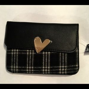 Mini Black crossbody bag with heart magnetic clasp